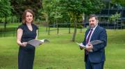 Prof Siobhan O'Neill with Health Minister Robin Swann