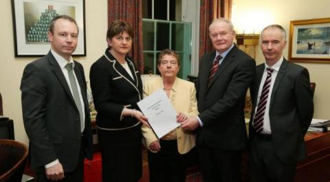 Prof. Eileen Evason (centre) along with Barry McVeigh (left) and Kevin Higgins (right), both members of her team that produced the Welfare Reform mitigation report, and the then First and deputy First Ministers