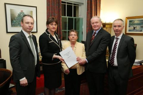 Eileen Evason (centre) with members of her team that produced the WR mitigation report as well as the First and deputy First Minister